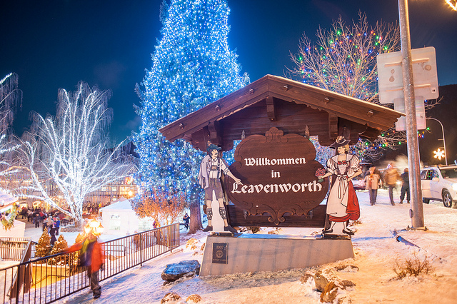welcome to leavenworth sign with christmas lights in background